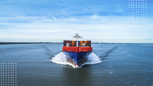 Cargo containership making waves in the ocean with blue sky